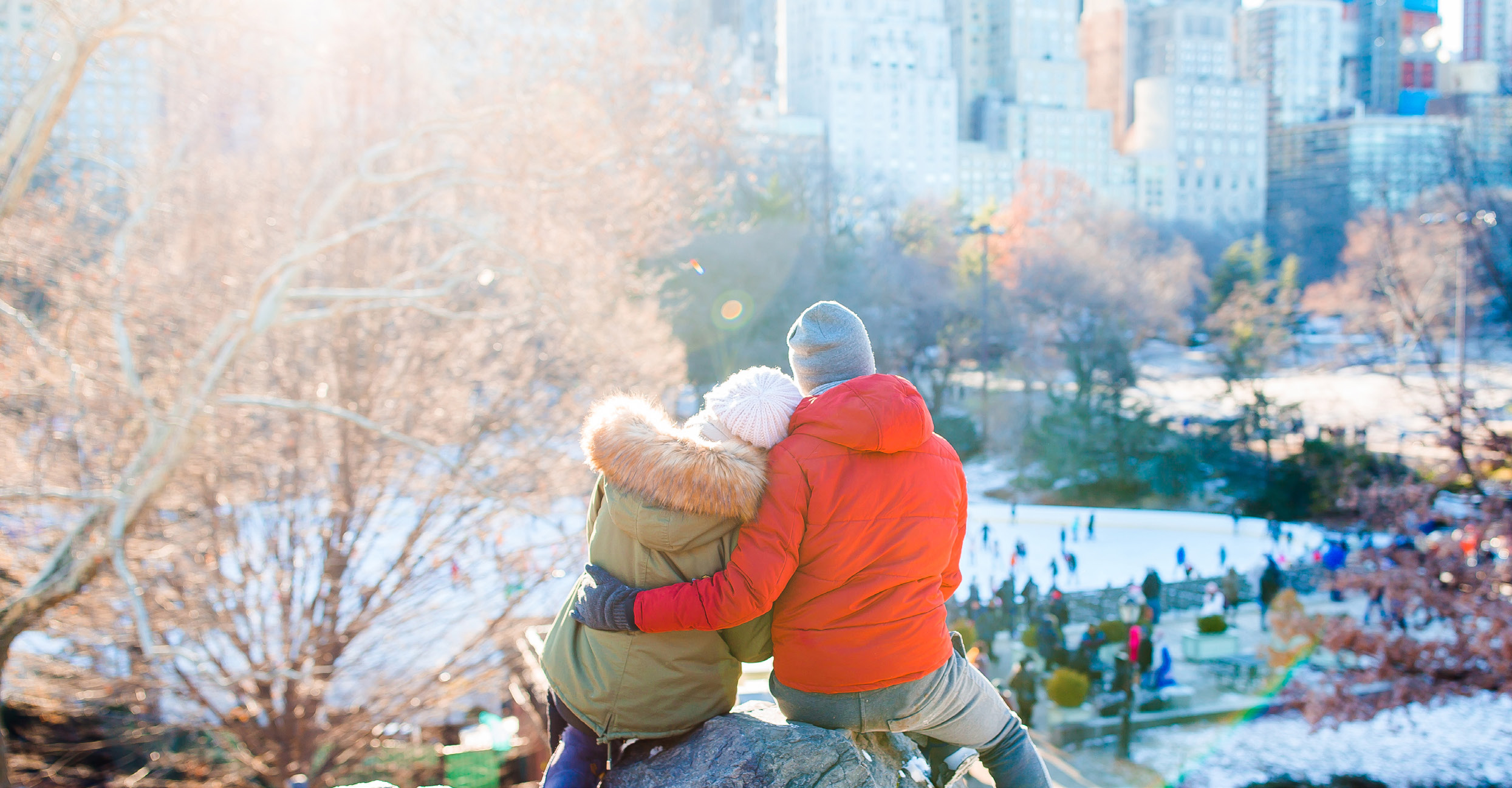 Happy couple enjoy the view of famous ice-rink